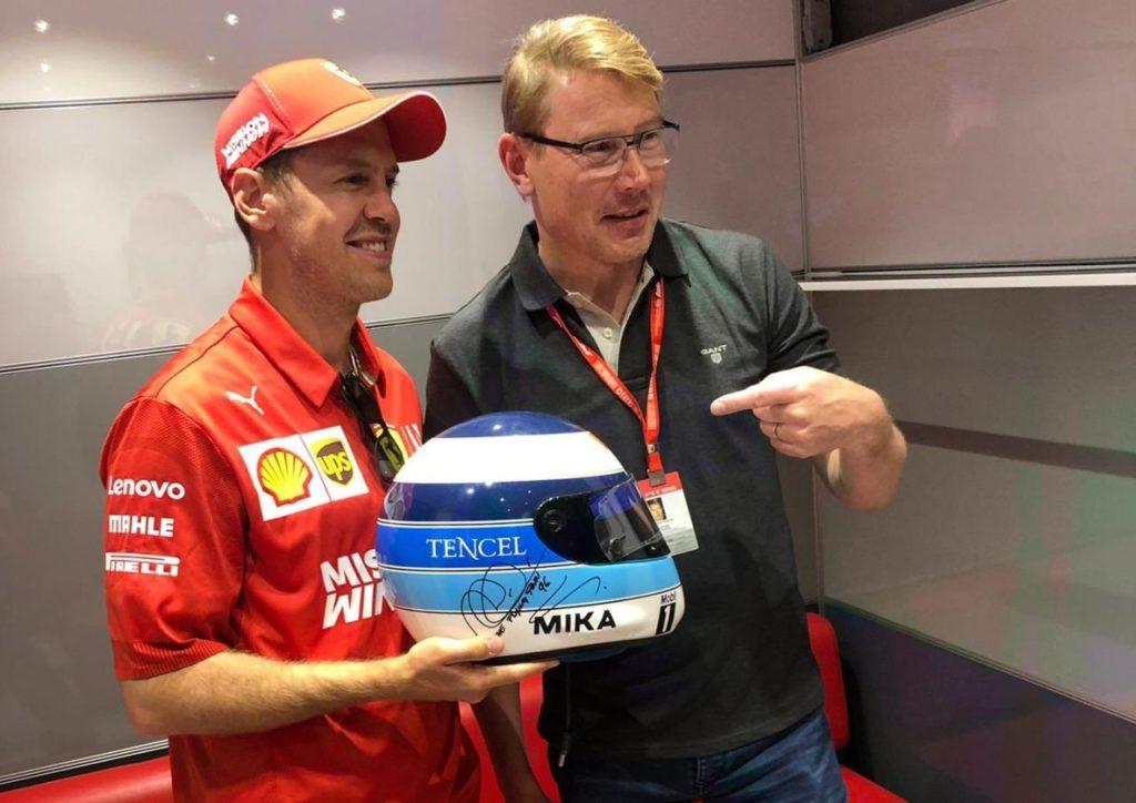 Sebastian Vettel e Mika Hakkinen